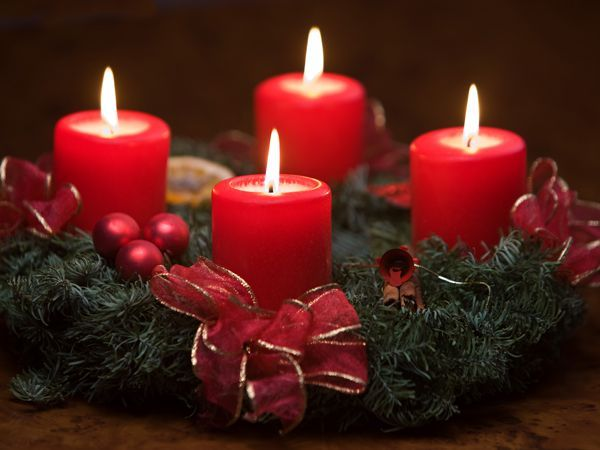 Four lighted candles on Advent